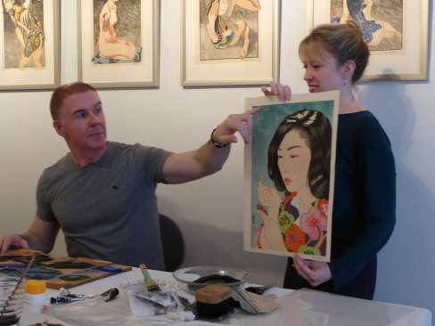 Binnie explaining his oil varnish technique used in the print's background (with Katherine Martin) thumbnail